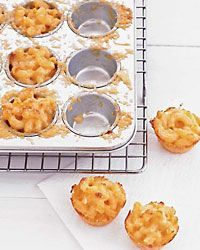 Three-Cheese Mini Macs | Anything big made small is ultrafun for cocktail parties, and these quick, one-bite mac and cheeses are the ultimate example. Cooked in mini muffin pans, the mini macs can be assembled early and baked just as guests arrive.