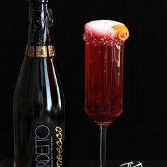 Cranberry Champagne Cocktail Recipe Beverages with champagne, cranberry juice, Grand Marnier, cranberry juice, sugar, orange