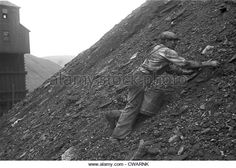 During the Great Depression a man salvages good coal from slag heaps at Nanty Glo, Pennsylvania, for which he is paid ten cents - Stock Image