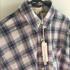Classic fit plaid shirt with sequins Lightweight (not flannel) plaid shirt with sequin appliqué on the front only. Love Stitch Tops Button Down Shirts