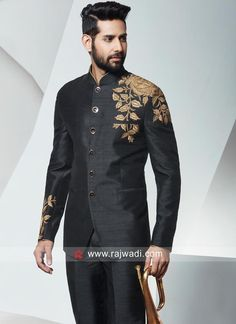 Dashing Black Raw Silk fabric long sleeve Jodhpuri is embroidered with machine work. Paired with matching bottom material. Fancy buttons on panel will make a good impression in front of your group. Men Wedding Attire Guest, Wedding Dress Men, Pakistani Wedding Dresses, Wedding Suits, Reception Suits, Raw Silk Fabric, Mens Kurta Designs, Fancy Buttons, Bollywood Wedding