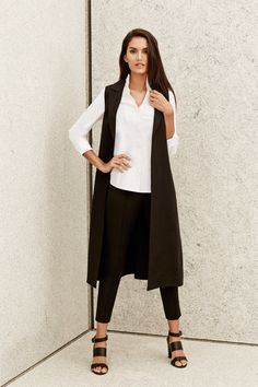 This chic vest offers a sleek and stylish update to your everyday wardrobe. Complete with a lapel collar, modern side slits, and hook and eye closure at the waist, this perfectly tailored vest creates instant drama when paired with your favorite Misook essentials.
