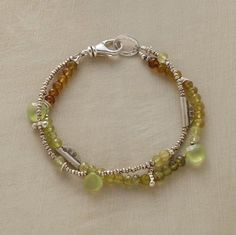 "MELISSA BRACELET -- Two strands orbit the wrist, one dominated by variegated prehnite, the other by a wide variety of sterling silver beads. Prehnite briolettes are standout accents. Handcrafted for us in USA. Lobster clasp. Approx. 7-1/2""L."