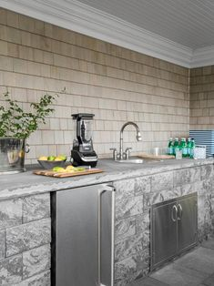 The outdoor kitchen includes a sink and refrigerator to make meal prep and drink mixing a breeze. Herringbone Wood Floor, Patio Kitchen, Indoor Outdoor Living, Outdoor Spaces, Rustic White, Kitchen Cabinet Design, My Dream Home, Dream Homes, Hgtv