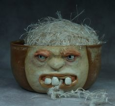 Wheel thrown, hand altered and sculpted ceramic yarn bowl. Just a friendly face to join you while you knit or crochet.