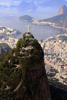 Rio de Janeiro Christ the Redeemer (Cristo Redentor) looking over the city with Sugarloaf Mountain (Pao de Acucar) in the background. Image by Frederick Millett