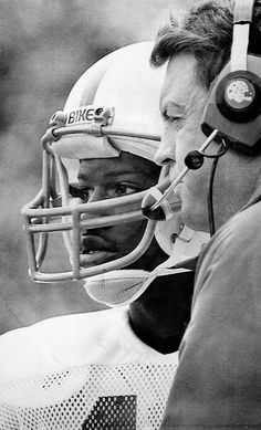 Turner Gill and Tom Osborne on the sideline during a fourth quarter discussion in 1981. THE WORLD-HERALD