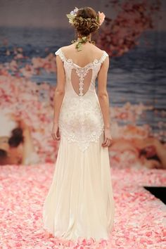 "Claire Pettibone's ""Thalia"" wedding dress from her Bridal Spring 2013 Collection features an elegant ivory embroidered floral lace back wedding gown with illusion back detail and silk velvet skirt. {Designed by Claire Pettibone} 
