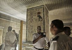 Tutankhamun's tomb may contain two hidden chambers, Egypt's antiquities minister said. A policeman takes a selfie at the Amenhotep II tomb in the Valley of the Kings in Luxor, Egypt