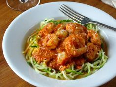 Shrimp and scallops in a pink tomato cream sauce over zoodles. #primal #glutenfree #grainfree #zoodles #paleo