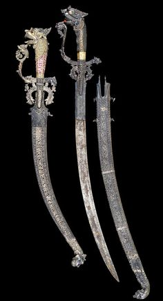 # Two silver-gilt-hilted Singhalese Swords (kastanes).