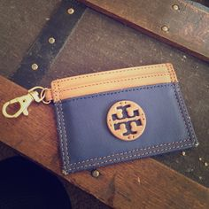 Tory Burch Card Holder Tory Burch card holder with keychain. 5 slots for cards. Worn on the edges Tory Burch Accessories Key & Card Holders