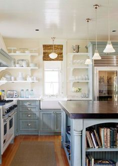 Like the cabinets, love the open shelves and farmhouse sink but never have a glass-door refrigerator unless you are the neatest most organized person!!!!