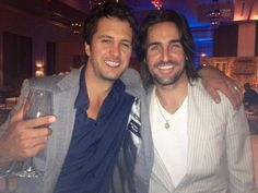 Jake Owen tweeted: Forgot we took this photo last night... I'm sure it had nothing to do with the alcohol consumption. With a picture of himself and Luke Bryan (With a wine glass in his hand) aaaahhh such beautiful men