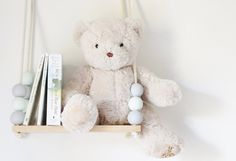 This handmade timber mini swing shelf, accented with beautifully painted wooden beads and rope is bound to be a darling addition to any nursery wall. It's $29 from Kimberley Jake Designs.