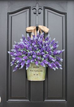 Is there anything prettier than a big bouquet of lavender? Visitors and passerby will be instantly taken with your home as they walk by this beautiful display. (This one features faux lavender, but if you're making your own, you can sub in dried lavender, too.) See more at Two Inspire You.  - GoodHousekeeping.com
