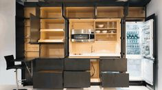 These Cabinets Hide an Incredible Stealth Kitchen.  Stealth Kitchen is the latest creation of Resource Furniture.