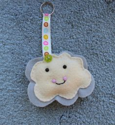 Funny little cloud key ring or bag charm made with grey and pink felt on Etsy, $57.08