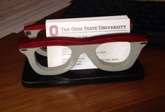 A cardholder made for an Ohio state buckeye fan. The mascot wears a frame…