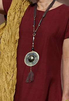 Hand hammered brass pendant with small ethnic beads ( agathe, glass beads, bone beads), brown waxed cotton threads