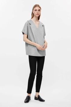 Made from smooth cotton jersey with a melange finish, this top has a pleated lapel detail at the front. A v-neck style, it is completed with short kimono sleeves, and a simple, straight hemline.