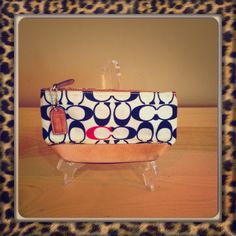 Coach Cosmetic Case A great addition to any coach bag! So cute and pretty clean- east to clean with soap & water! Coach Bags