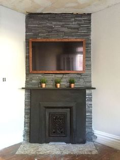 An old fireplace receives a strip down and build up makeover for only $102.00