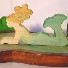 I so love wooden toys.. And I know a certain little girl who'd think the world of this sweet mermaid.