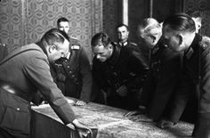 Soviet and German officers at the demarcation line examine a map. 21 September 1939 [Bundesarchiv, Bild 101I-121-0010-11 / CC-BY-SA 3.0| Wikipedia]