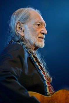 Willie Nelson performs during the 2013 Berklee College Of Music Commencement Concert at Berklee College of Music on May 10 in Boston. (Photo by Paul Marotta/Getty Images)