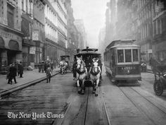 "Horse Cars Last Days - 1917. Just before the last of these vehicles was banished from the streets of New York City, a photographer snapped one of them as it passed alongside a ""Modern Electric Car."""