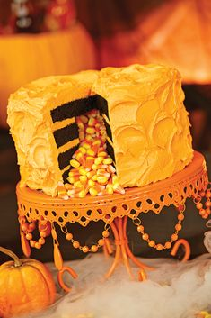 ThisCandy Corn Surprise Cake @BuyCostumes.com and @Sandrashm are making me so hungry right now! #OrangeTuesday #ad  - Yum!