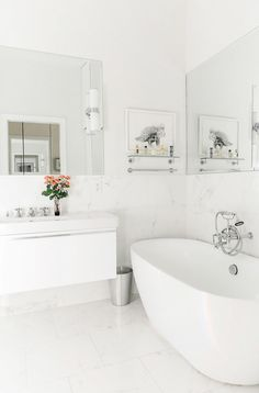 Bathroom With A Floating Tub, And Marble Floors