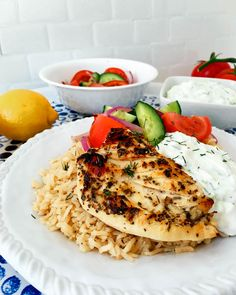 Simple Greek Grilled Chicken Rice Bowl served with a fresh and vibrant salad and delicious tzatziki! March 25th is a double holiday in Greece and for GreekGreek Chicken Rice Bowlannunciation of mary, bakaliaros, chicken breast, cucumber, Fage, Garlic, greek, greek chicken, greek independance, greek salad, grilled chicken, lemon, Olive oil, oregano, red onion, Rice, rice bowl, salad, skordalia, tomatoes, tzatzikiBaked AmbrosiaAthlete Approved, Lunch, Main Dishes, Soup/Salad