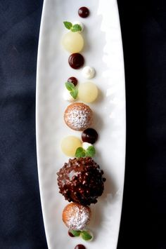 frozen sheep yogurt in dark chocolate with toasted almonds, green apple beignet
