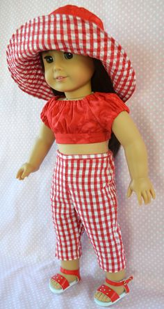 This American Girl doll outfit is just darling, love the details on the hat and top, so cute! Some great designs on this blog for 18 inch dolls!