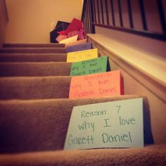 Seven reasons why you love your husband with a love note and his gift at the top of stairs. Nefty v-day gift