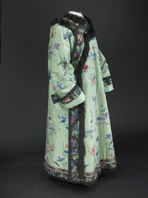 Helen Taft's green satin Manchu-style coat is embroidered with spring and summer symbols of goldfish and lotus flowers, but is lined with fleece. The fur trim is not typical of the Chinese style and was probably added as a custom order.