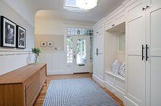 storage with doors; wall paneling; skylight