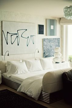 love the all white and dusty blue accents but I'm not sure about that wall art...