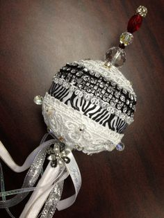 Bride's Bouquet:  A princess scepter instead of flowers.  Made with styrofoam, 18 inch Wooden rod.  covered with fabric, with ribbon and trim overlay, top with large beads using a long coursage pin and glued to sit firm on the ball. Add ribbons and piece of jewelry accent.
