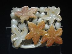 Chinese Jade Culture - This is a Chinese ornament with a flower design. It is currently being held in the Shanghai Museum.