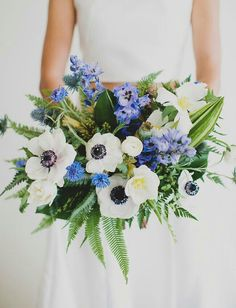 "Gorgeous ""Free Form"" Bridal Bouquet: Blue Eryngium Thistle, Blue Delphinium, Blue Corn Flower, White Anemones, White Tulips, White Ranunculus, Green Leather Leaf Fern, Green Sword Fern, + Several Other Varieties Of Greenery/Foliage"