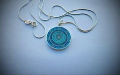 This is a cloisonne enamel pendant, which was made in sterling silver. Item will be sale with silver chain.