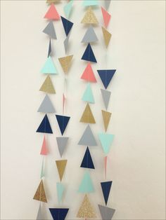 Gold Mint Navy Coral Grey Triangle Garland. Geometric Garland. Paper Backdrop. Tribal Party. Baby Shower. Birthday Garland. Photo Prop by LaCremeBoutique on Etsy https://www.etsy.com/listing/195886341/gold-mint-navy-coral-grey-triangle