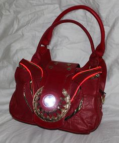 This Iron Man Purse Has An Arc Reactor That Lights Up