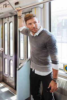 Shop this look on Lookastic:  http://lookastic.com/men/looks/grey-crew-neck-sweater-white-long-sleeve-shirt-black-jeans/7256  — Grey Crew-neck Sweater  — White Long Sleeve Shirt  — Black Jeans