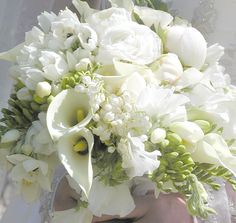 You can't ever go wrong with an all white bridal bouquet.  This one features peonies, lily-of-the-valley ranunculus and mini calla lilies.