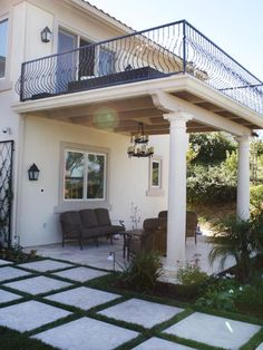 Building a raised balcony similar to this off of a living room or master bedroom area is my dream... But enclose the balcony, and not have it be built from stone like material, but rather wood like materials.