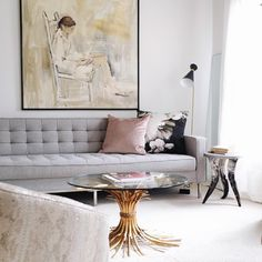 large statement art over mid century modern gray sofa love the mix of the brass hollywood regency coffee table #livingroom #livingroomdecor #homedecor
